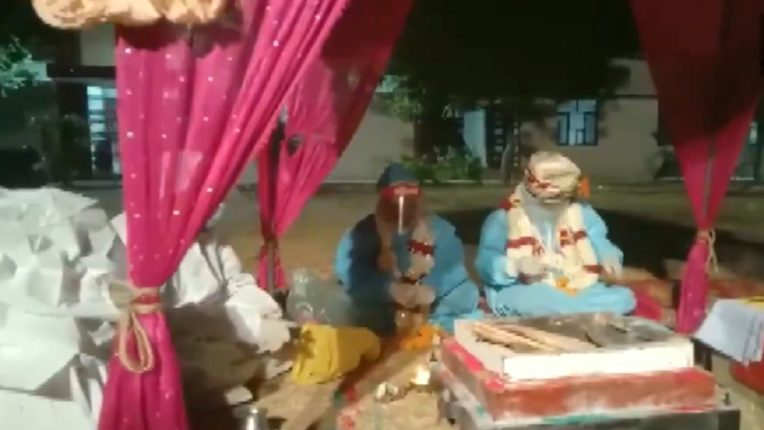 Rajasthan: A couple gets married at Kelwara Covid Centre in Bara, Shahbad wearing PPE kits