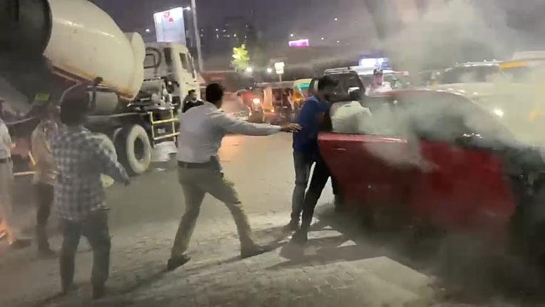 burning car saved by traffic police