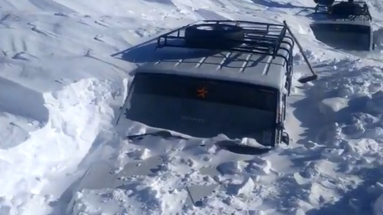 two passenger vehicles got trapped in the snow at Razdan