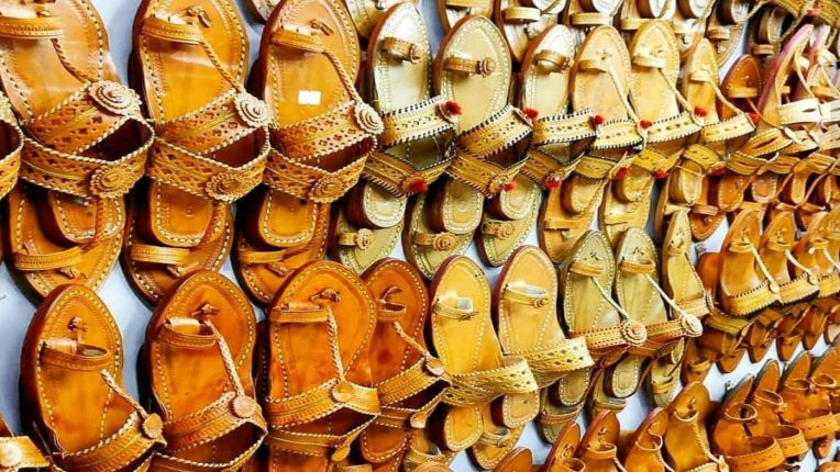 By creating a brand of Kolhapuri slippers Create sales reports in large stores - Dr. Viswajit Kadam