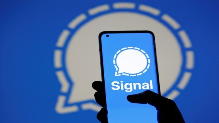 The Signal messaging app logo is seen on a smartphone, in front of the same displayed same logo, in this illustration taken, January 13, 2021. REUTERS/Dado Ruvic - RC2A7L9SIA61
