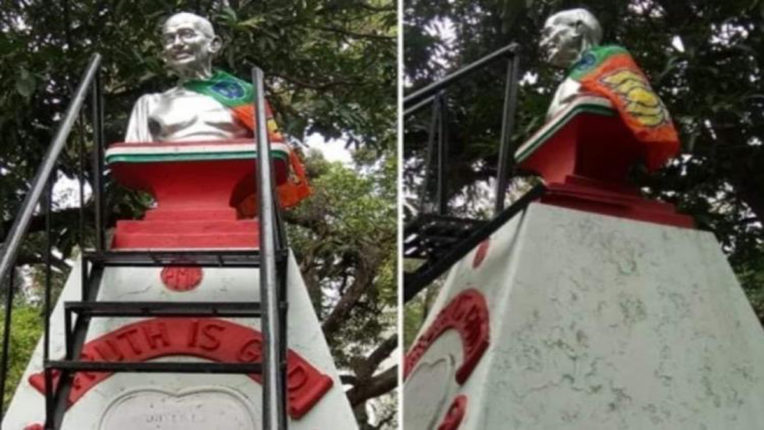 bjp flag on gandhi idol