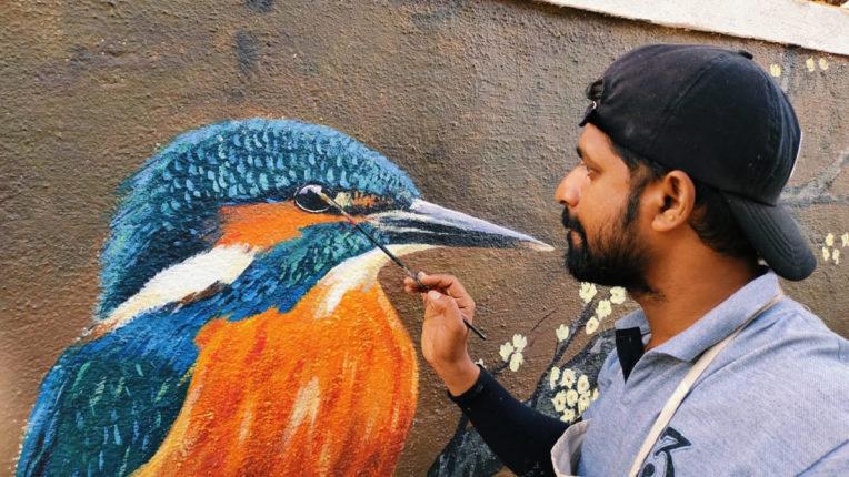 artist painting at pali