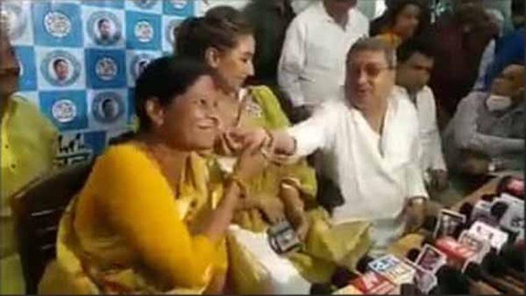 kalyan banerji touches cheek of a woman