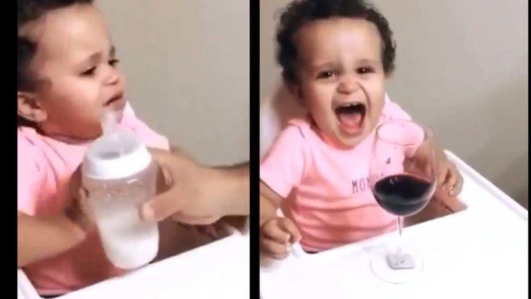 kid happy to see wine glass