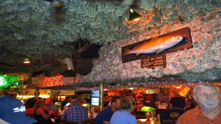 pub with a notes attached to ceiling